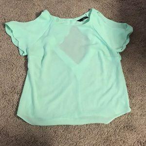 Sheer pale green blouse